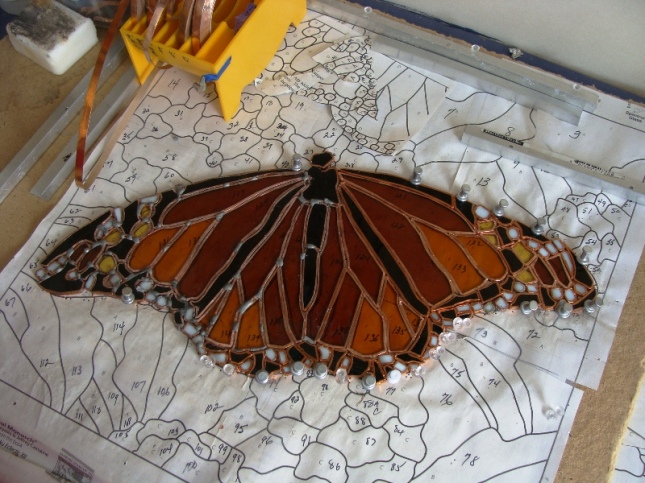 Carol is working on a Monarch Butterfly in stain glass.